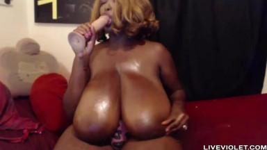Ebony fetish mistress with enormous 36M black boobies