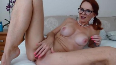 Busty horny red MILF April with freckles seeks playmates