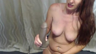 Red MILF Kelsey Rae with long tongue enjoys her new toy