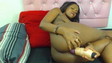 Booty black coed takes white dildo in her ebony hot ass