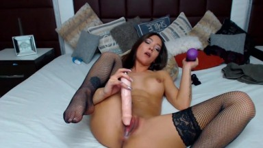 Hot brunette Carmina with big implants fucks creamy cunt