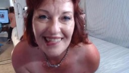 Red mature lady Dawn loves to smile and talk about sex