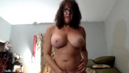 Naughty granny Nicki Brice with massive tits and glasses